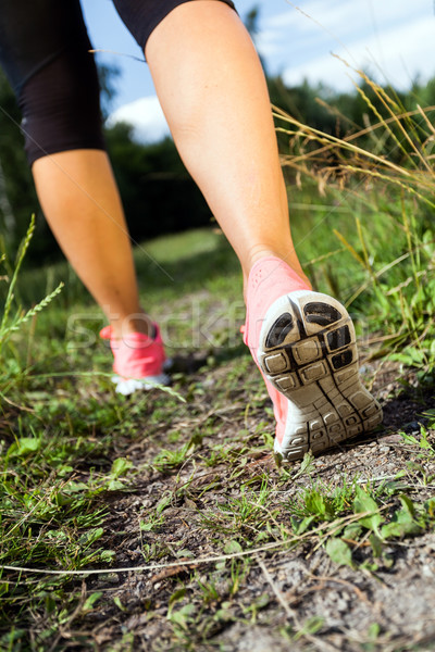 Stock photo: Walking or running legs in forest, summer nature activity