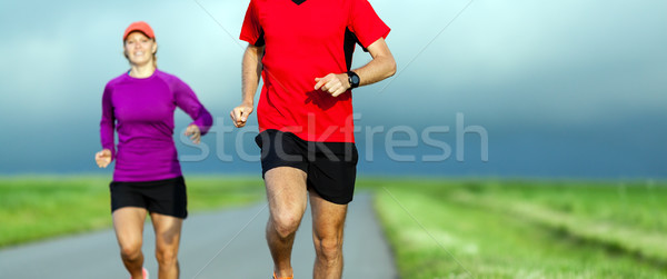 Stock photo: Couple running on country road