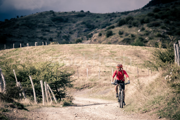 Mountain bike rider on country road, track trail in inspirationa Stock photo © blasbike