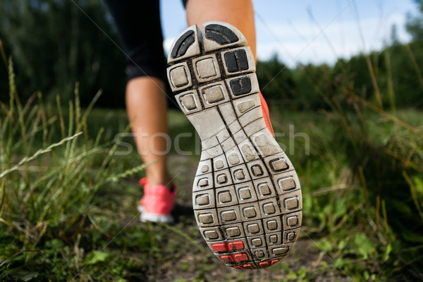 Woman and running shoes in forest, exercising in nature Stock photo © blasbike
