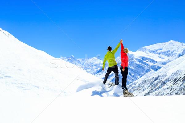 Teamwork motivation, success in winter mountains Stock photo © blasbike