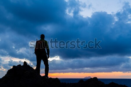 Hiking silhouette backpacker, inspirational sunset landscape Stock photo © blasbike
