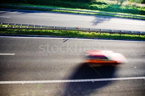 Piros autó bemozdulás elmosódott száguld autópálya Stock fotó © blasbike