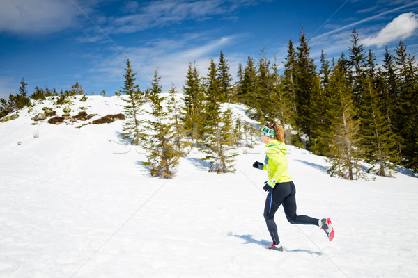 Woman winter running in beautiful inspirational landscape Stock photo © blasbike