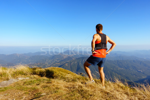 Hiker or runner looking at inspirational mountains landscape Stock photo © blasbike