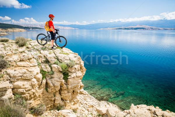 Mountain biker looking at view and sea Stock photo © blasbike