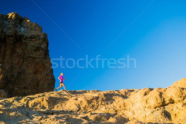 Woman trail running on rocky mountains Stock photo © blasbike