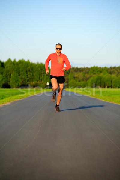 Man running on country road, training inspiration and motivation Stock photo © blasbike