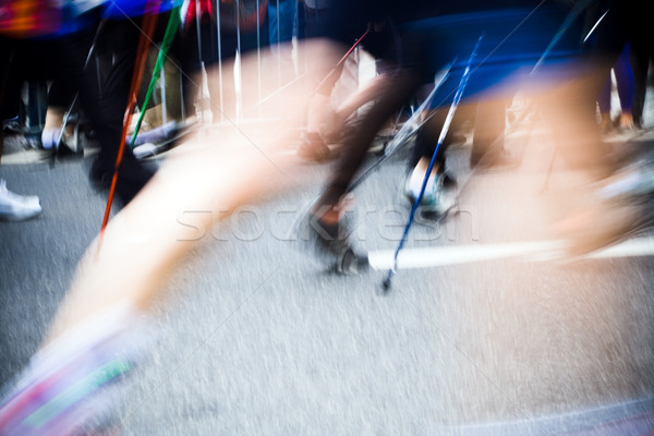 Nordic walking race in city, motion blur Stock photo © blasbike