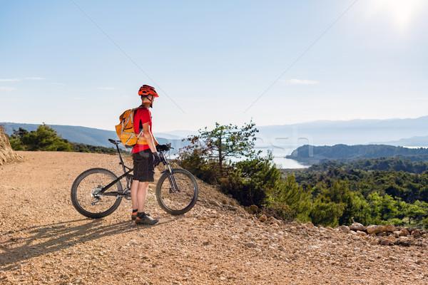 Mountain biker looking at the sea view Stock photo © blasbike