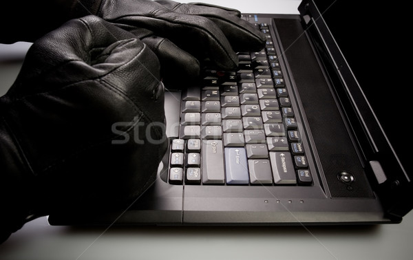 Mad hacker working on laptop at night Stock photo © blasbike