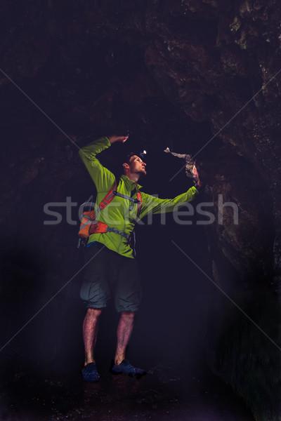 Man exploring underground dark cave Stock photo © blasbike