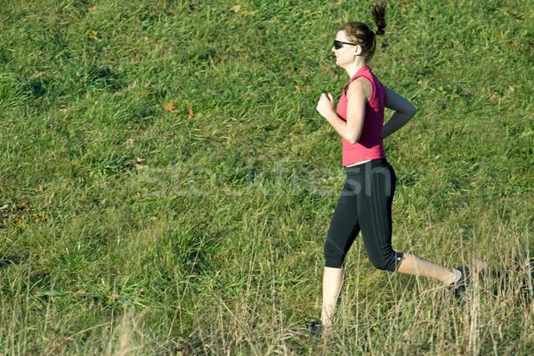 Woman running cross country Stock photo © blasbike