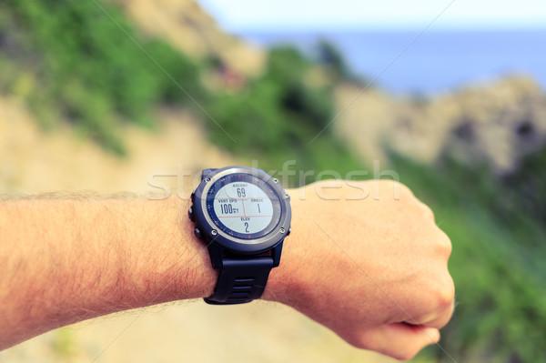 Runner looking at sport watch Stock photo © blasbike