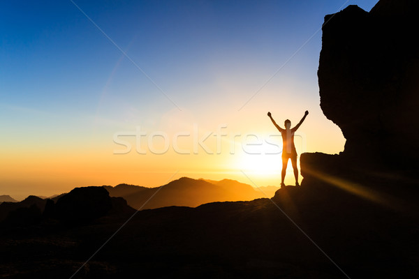 Woman climber success silhouette in mountains, ocean and sunset Stock photo © blasbike