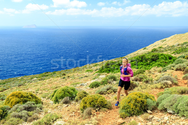 Happy woman cross country running in beautiful mountains Stock photo © blasbike