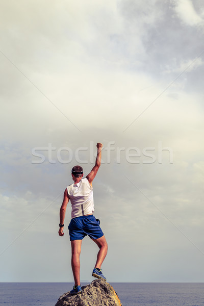 Happy winner reaching life goal success man Stock photo © blasbike