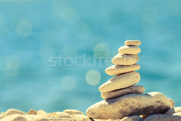 Stones balance at the beach, stack over blue sea Stock photo © blasbike