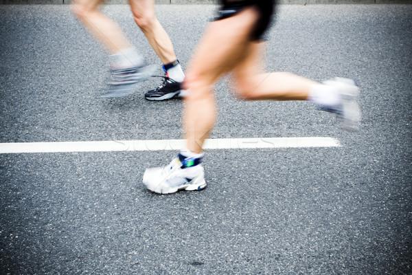Stock photo: People running in marathon race on city streets