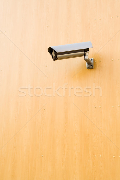 Security camera over brown background Stock photo © blasbike