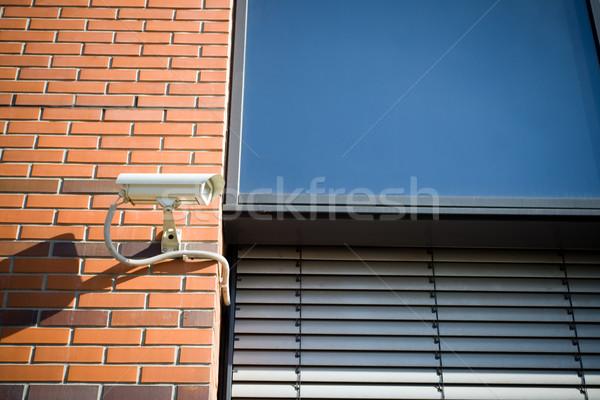 Biztonsági kamera modern épület épület televízió fal technológia Stock fotó © blasbike