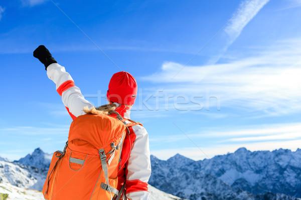 Hiking success, happy woman in winter mountains Stock photo © blasbike