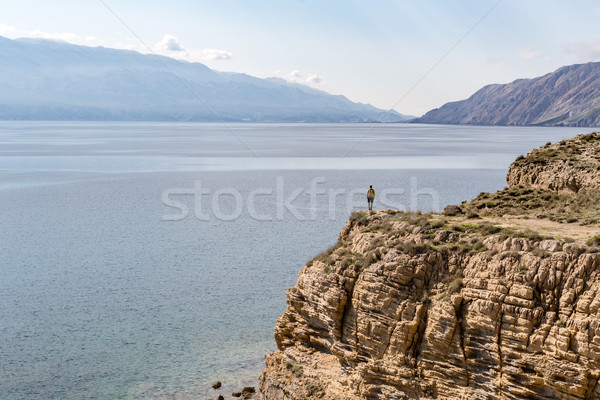 Hiking man, climber or trail runner in mountains Stock photo © blasbike