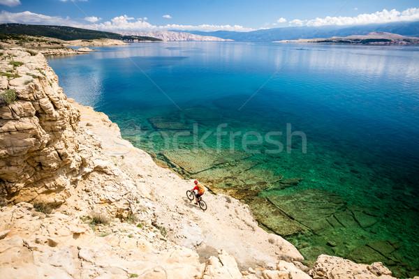 Mountain biker riding on bike in summer seaside Stock photo © blasbike