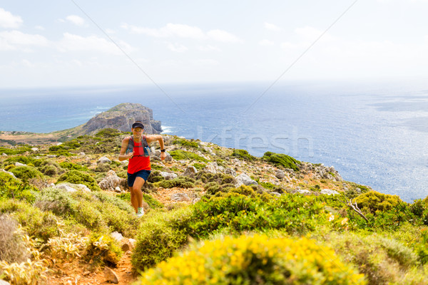 Happy trail running man in inspirational mountains Stock photo © blasbike