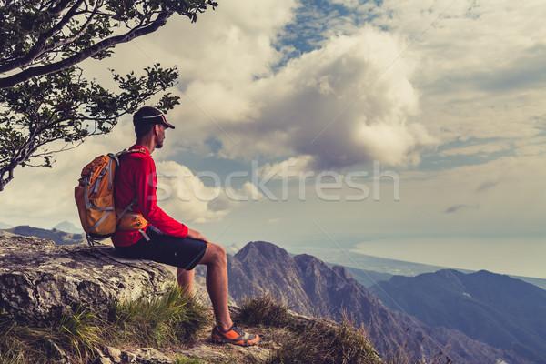 Hiking man or trail runner looking at mountains Stock photo © blasbike