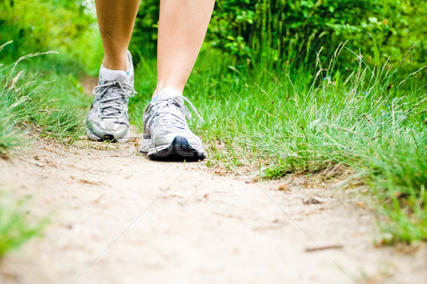 Stock photo: Woman walking on trail in forest