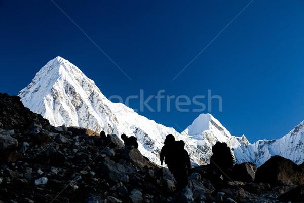People silhouette hiking in mountains Stock photo © blasbike
