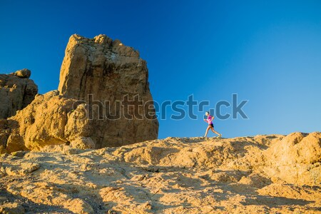 Woman running on rocky mountains, training and working out Stock photo © blasbike
