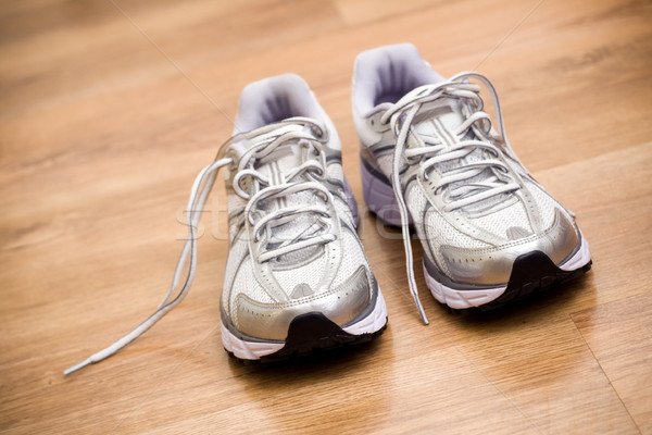 Stock photo: Running shoes after workout at gym
