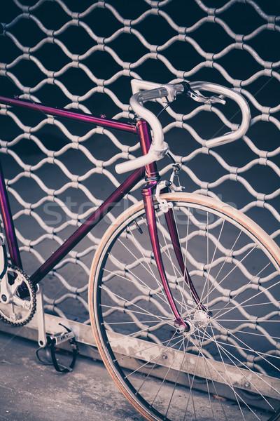 Road bicycle and concrete wall, urban scene vintage style Stock photo © blasbike