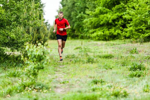 Man cross country running on trail Stock photo © blasbike