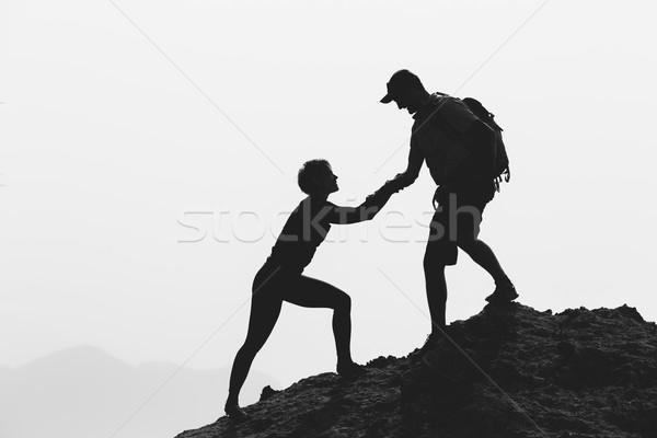 Munca în echipă cuplu Drumeţii alpinism mana de ajutor încredere Imagine de stoc © blasbike