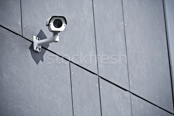 Stock photo: Security camera on office building wall