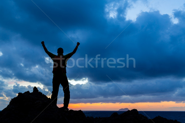 Happy winner reaching life goal successful man Stock photo © blasbike