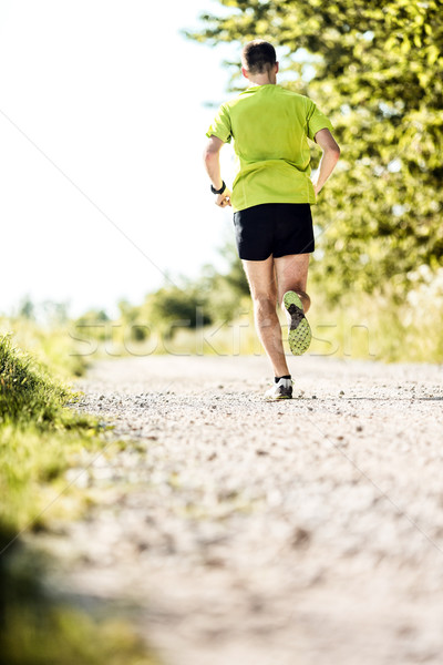 Man jogging in summer on country road Stock photo © blasbike