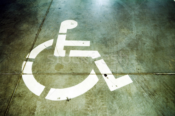 Disability sign on grunge garage floor Stock photo © blasbike