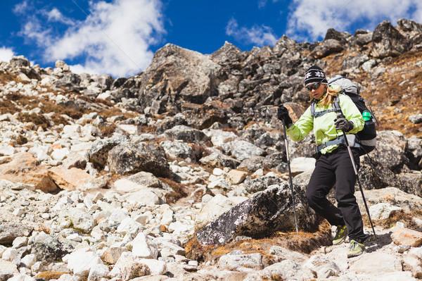 Woman hiking in Himalaya Mountains on Rocky Trail Stock photo © blasbike