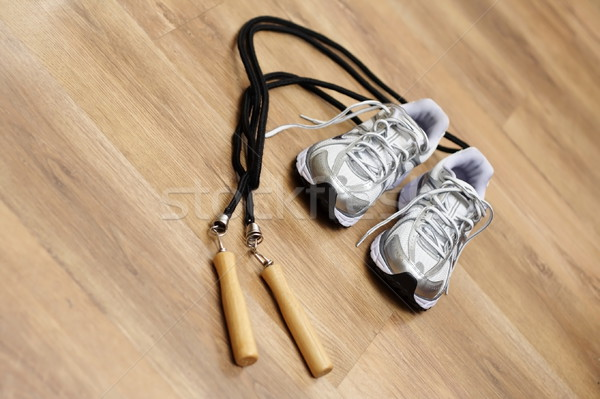 Jumping rope and trainers in gym Stock photo © blasbike