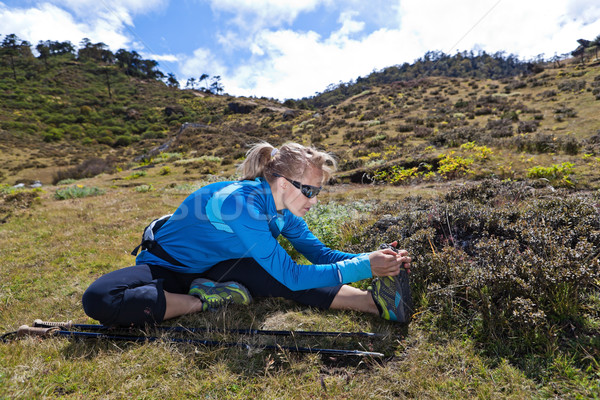 Woman exercising and stretching in mountains Stock photo © blasbike