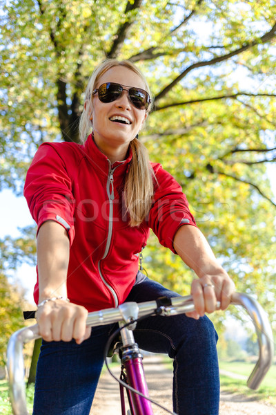 Happy woman cycling on bicycle Stock photo © blasbike