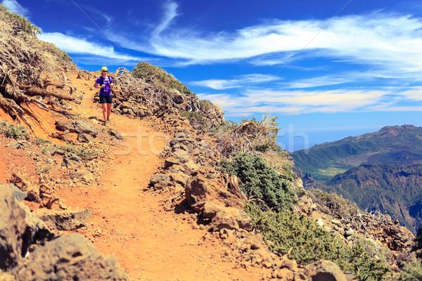 Trail runner woman, walking in mountains Stock photo © blasbike