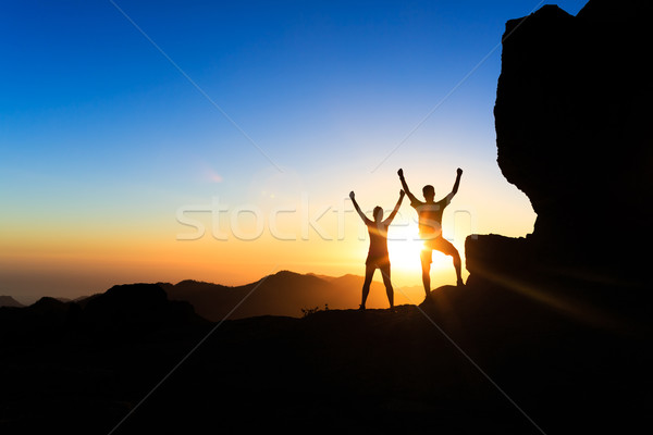 Couple teamwork people, inspiring success in mountains Stock photo © blasbike