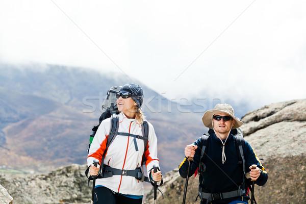 Couple hiking in mountains Stock photo © blasbike