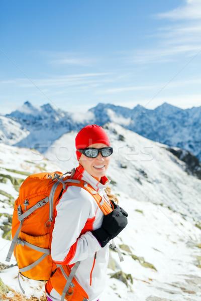 Hiking and walking woman in winter mountains Stock photo © blasbike