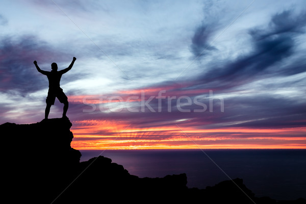 Man hiking silhouette in mountains, ocean and sunset Stock photo © blasbike